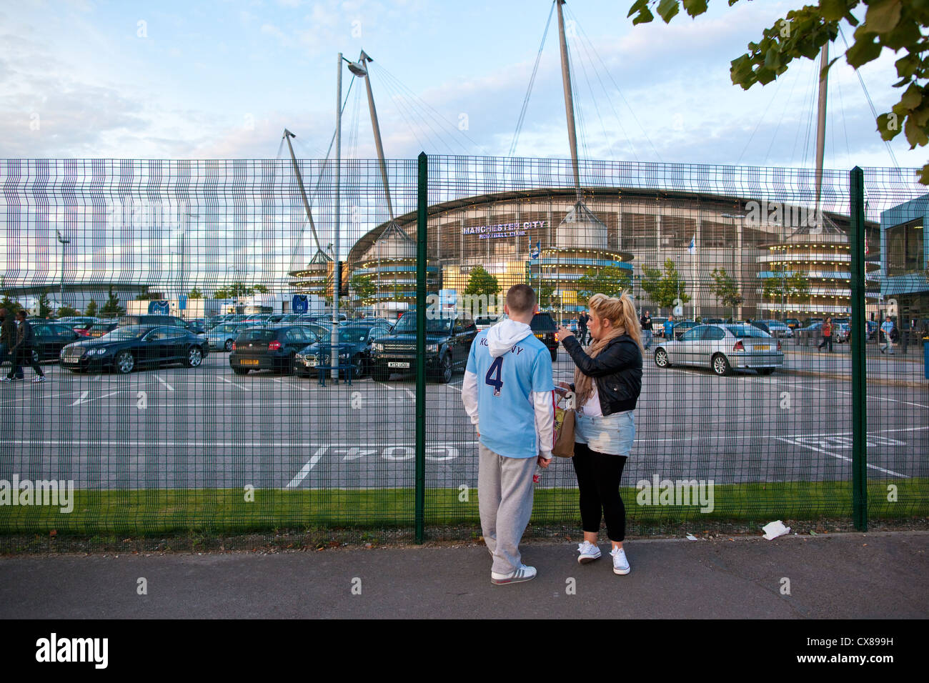 Teenage children at the perimeter fence of manchester City Etihad Stadium, Manchester, England, United Kingdom - Stock Image