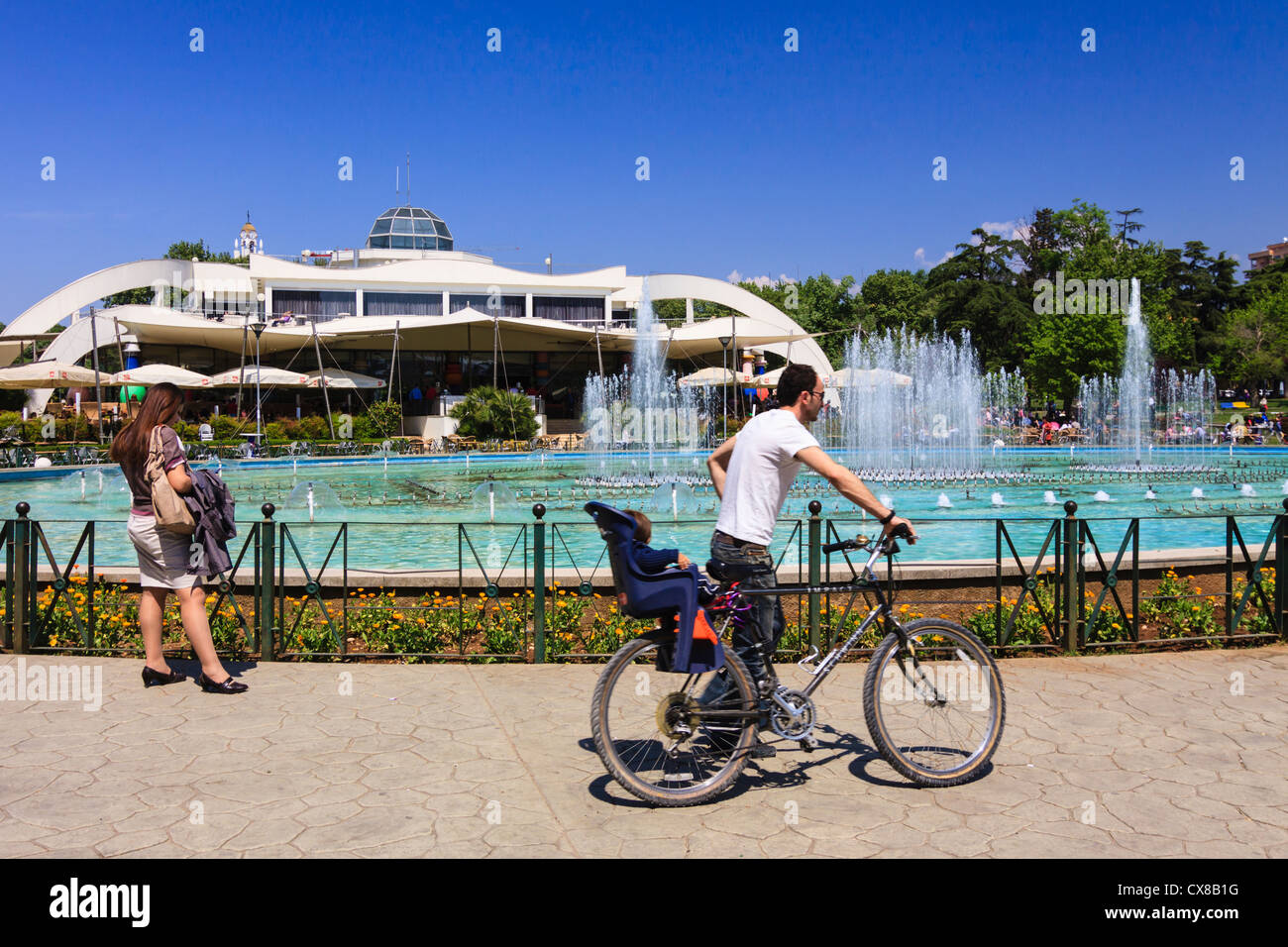People by Taiwan entertainment center in Rinia Park, Tirana, Albania - Stock Image
