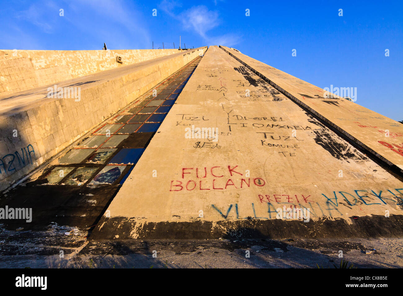 Graffitis covering the Pyramid, the former International Center of Culture known also as the Enver Hoxha museum. - Stock Image