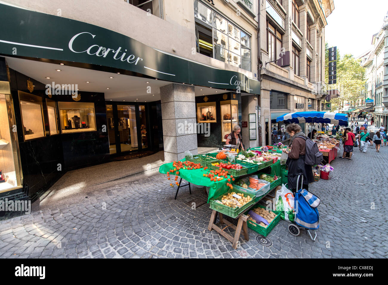 Street food market by Cartier jewellery jewelry shop in Lausanne Switzerland - Stock Image