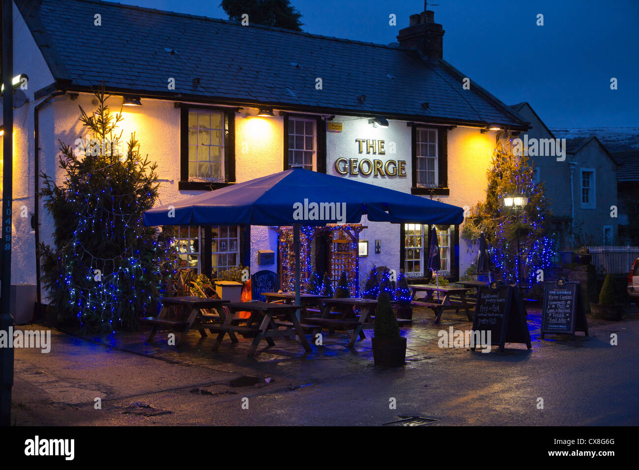 Christmas lights in  the high street of the Peak District village of Castleton Derbyshire England Stock Photo