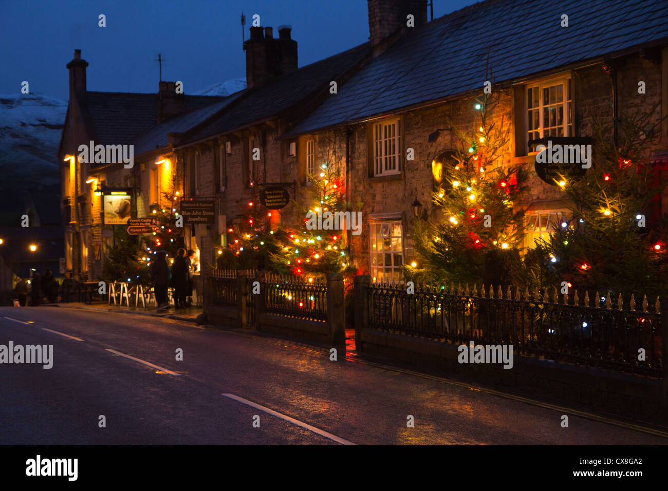 Christmas lights in the high street of the Peak District village of ...