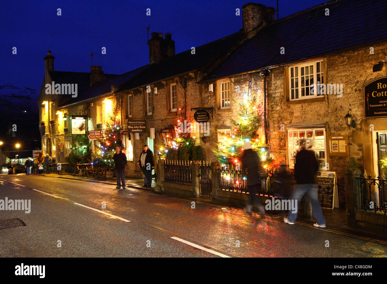 Christmas lights in the high street of the Peak District village of Castleton Derbyshire England & Christmas lights in the high street of the Peak District village of ...