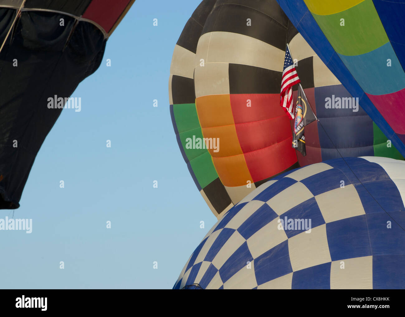 A balloon carries the U.S. flag during the 21st annual White Sands Balloon Invitational at White Sands National Stock Photo
