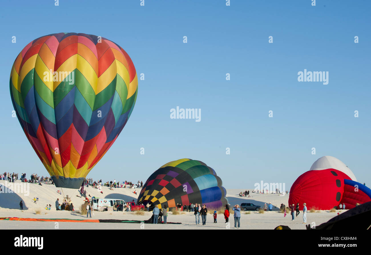 The pilots and crews inflate their balloons during the 21st annual White Sands Balloon Invitational at White Sands Stock Photo