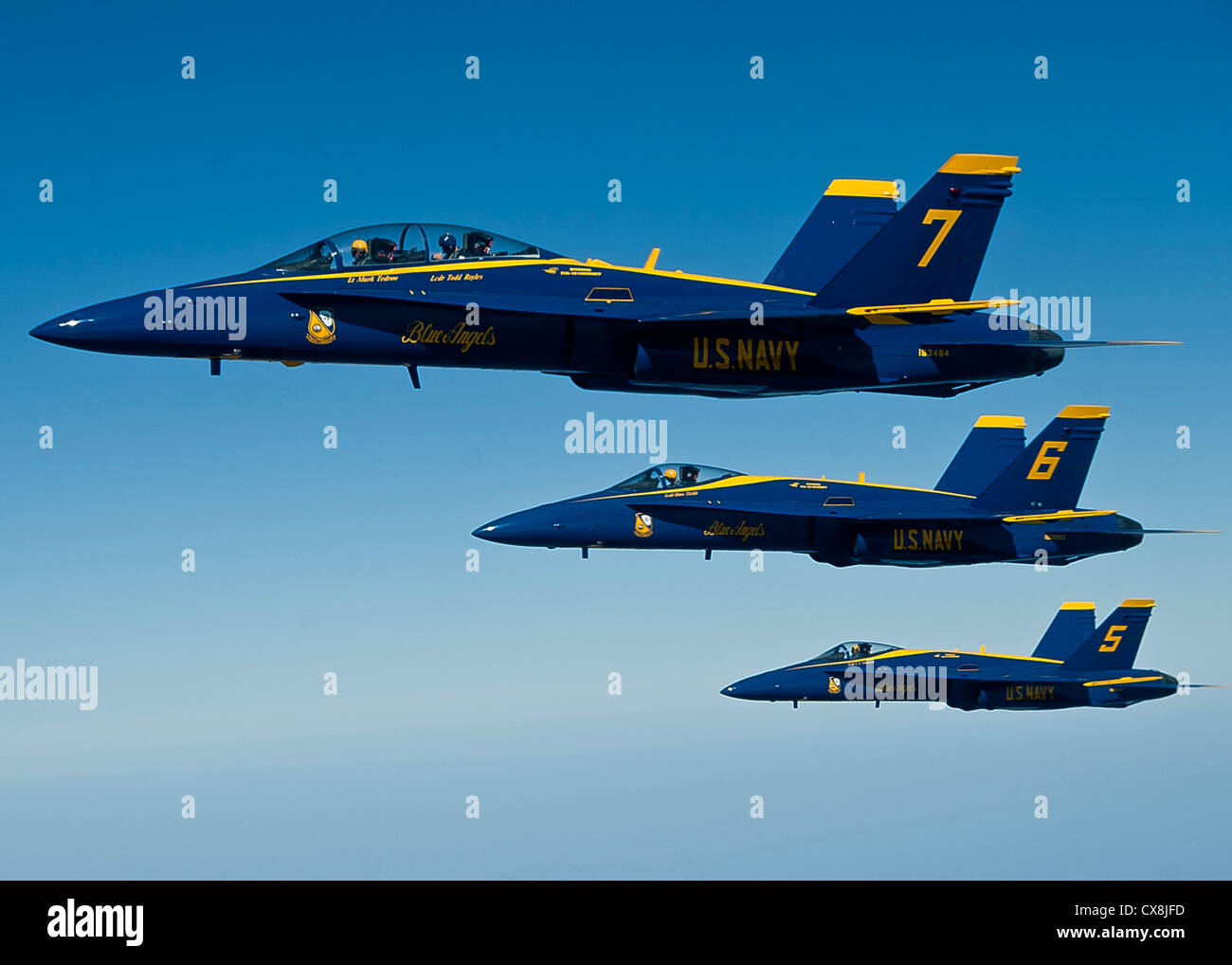 A formation of Navy Blue Angel FA-18 Hornets from Naval Air Station Pensacola, Fla., fly together before being refueled Stock Photo