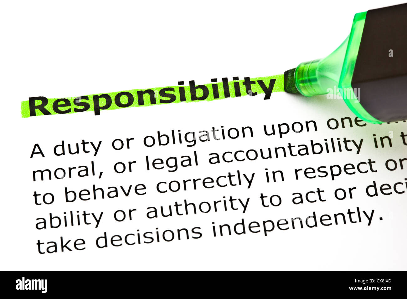 Definition of the word Responsibility highlighted in green with felt tip pen - Stock Image