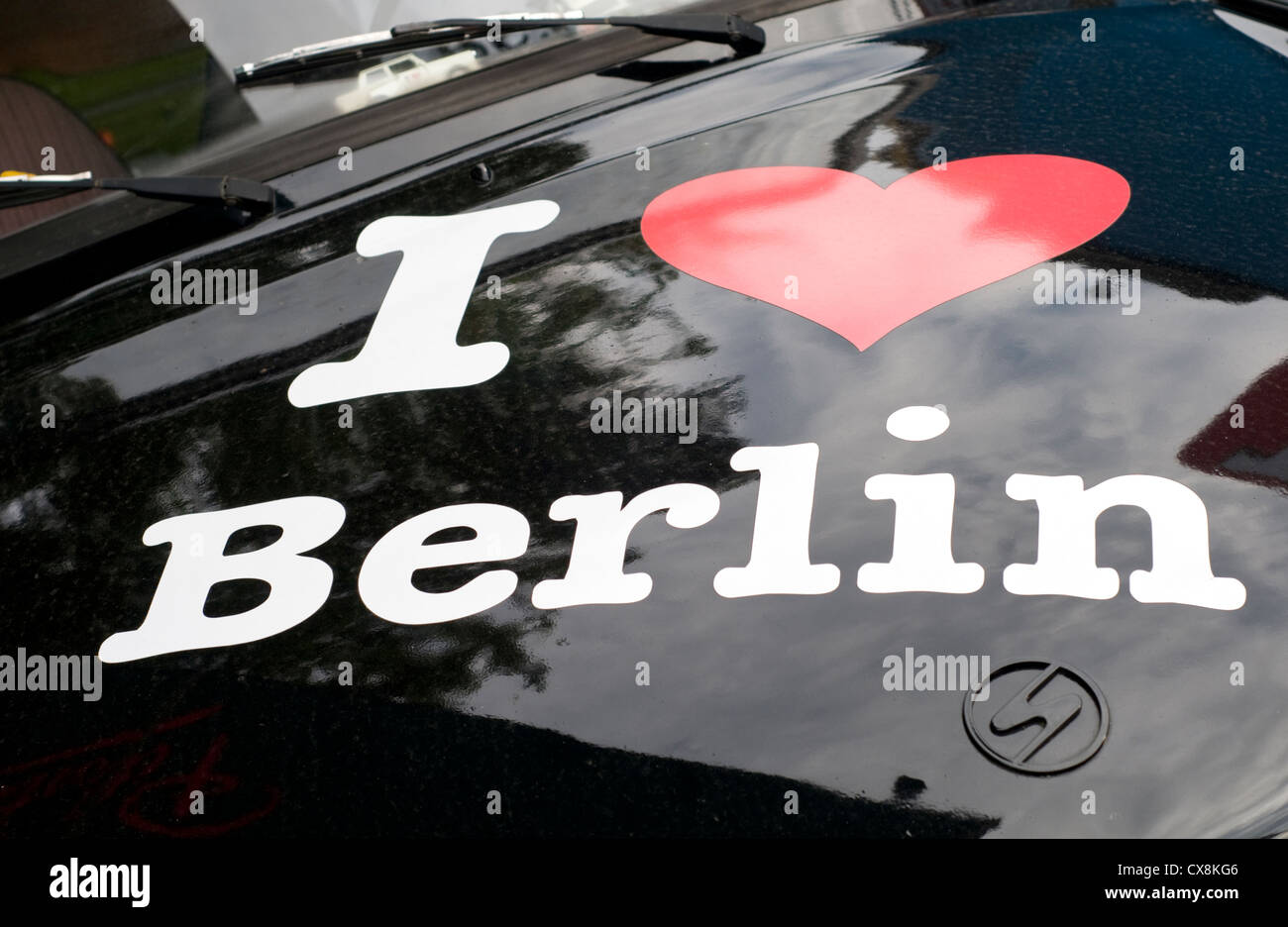 Detail of I love Berlin artwork on the bonnet of an old Trabant car - Stock Image