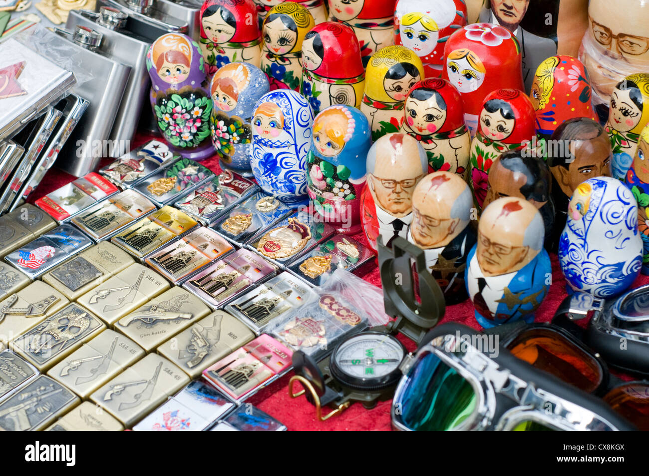 Souvenirs on a street stall near Checkpoint Charlie in Berlin, Germany - Stock Image