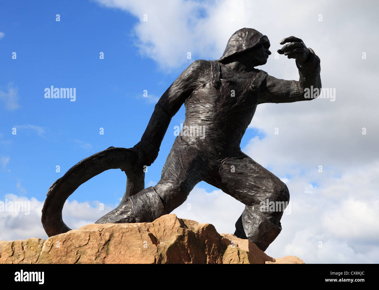 Bronze statue 'The Rescue' showing man with lifebelt at Seahouses, north east England UK - Stock Image
