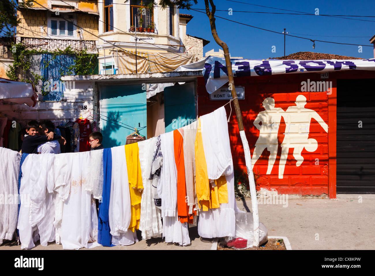 Albanian street scene with old villa, street market and football graffiti. Tirana, Albania - Stock Image