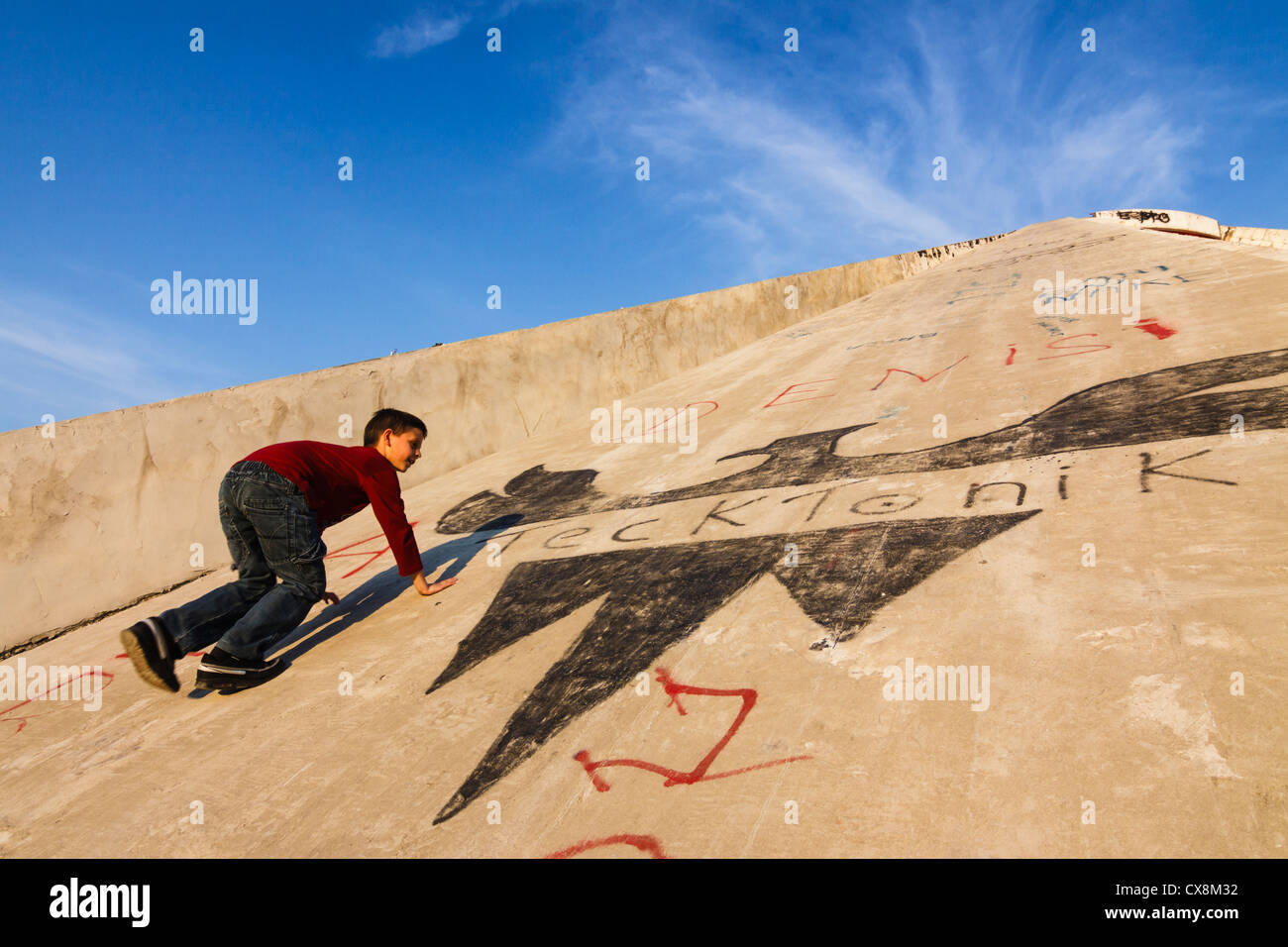 Child climbing up the Pyramid, the former International Center of Culture. Tirana, Albania - Stock Image