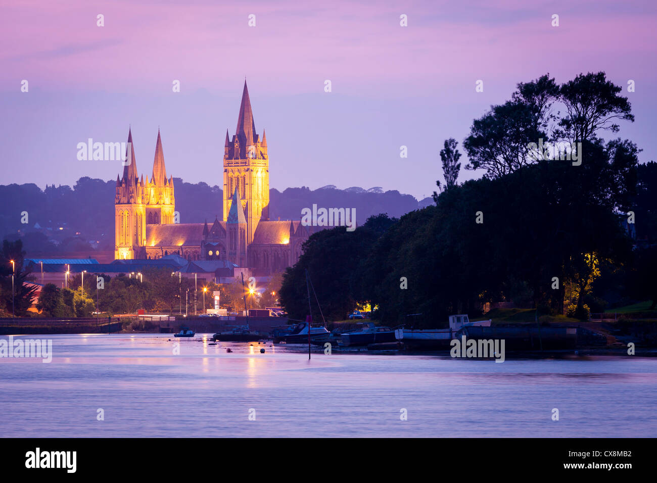 View up river at sunset from Malpas with Truro Cathedral in the background. - Stock Image