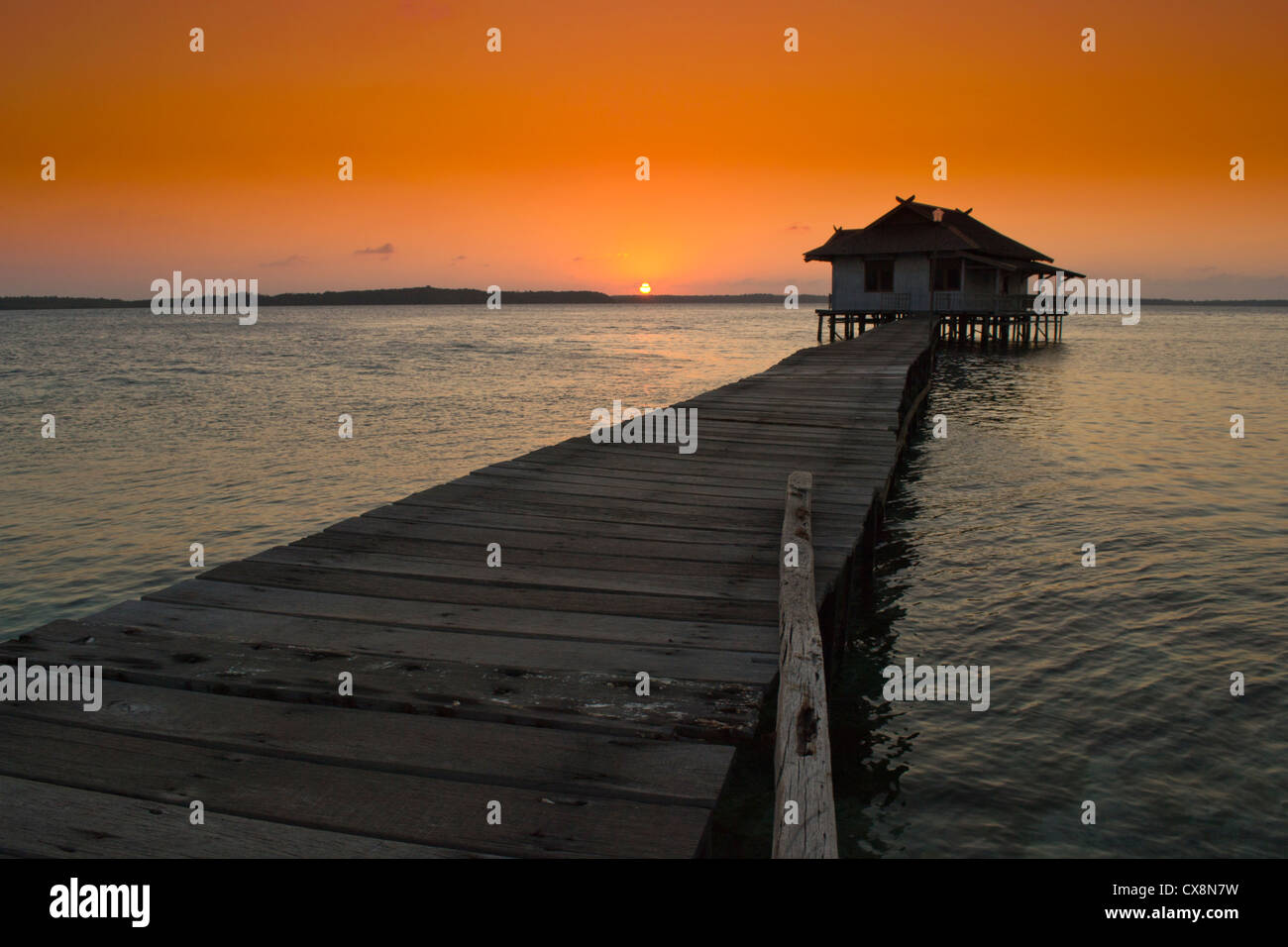 Overwater bungalow at sunset in Kalimunjava Island (Giava, Indonesia) - Stock Image