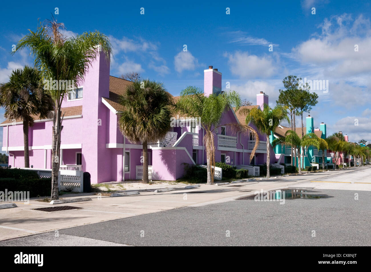 Row of Brightly colored Abandon condominiums due to recession - Stock Image