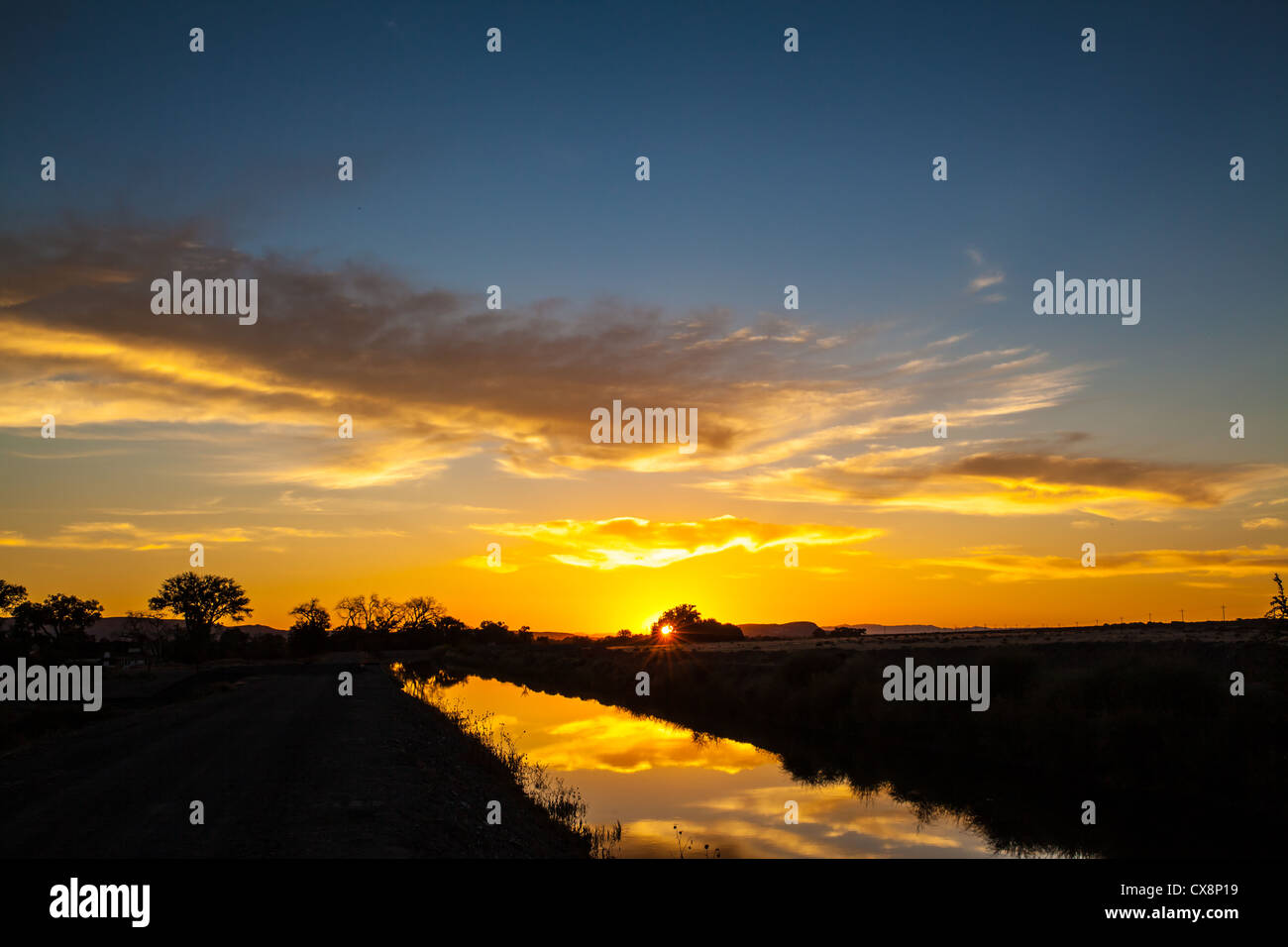 Sunrise over a canal in Fernley Nevada - Stock Image