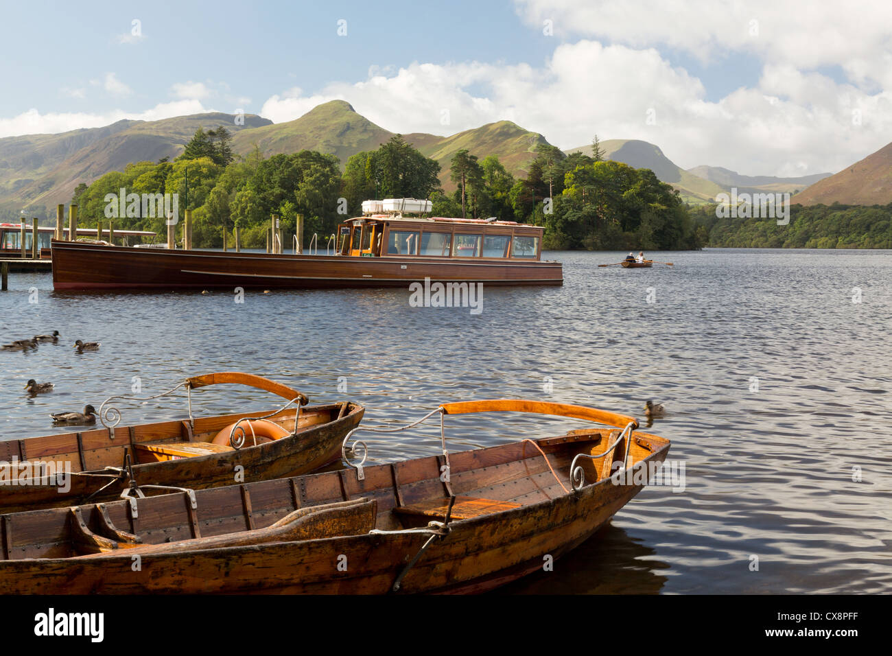 Piers / Landing stages, rowing boats and Launch on the edge of Derwent Water in English Lake District, UK in early Stock Photo