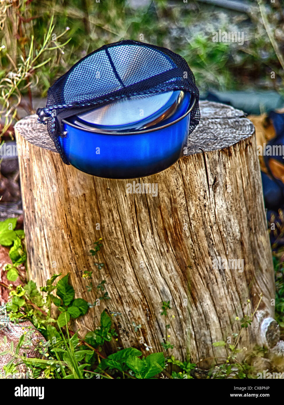Colorful Blue Stackable Hiking or Camping Pots and Pans - Stock Image