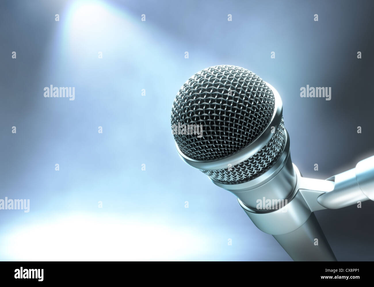 Modern microphone on a stage with lights for live performance. - Stock Image
