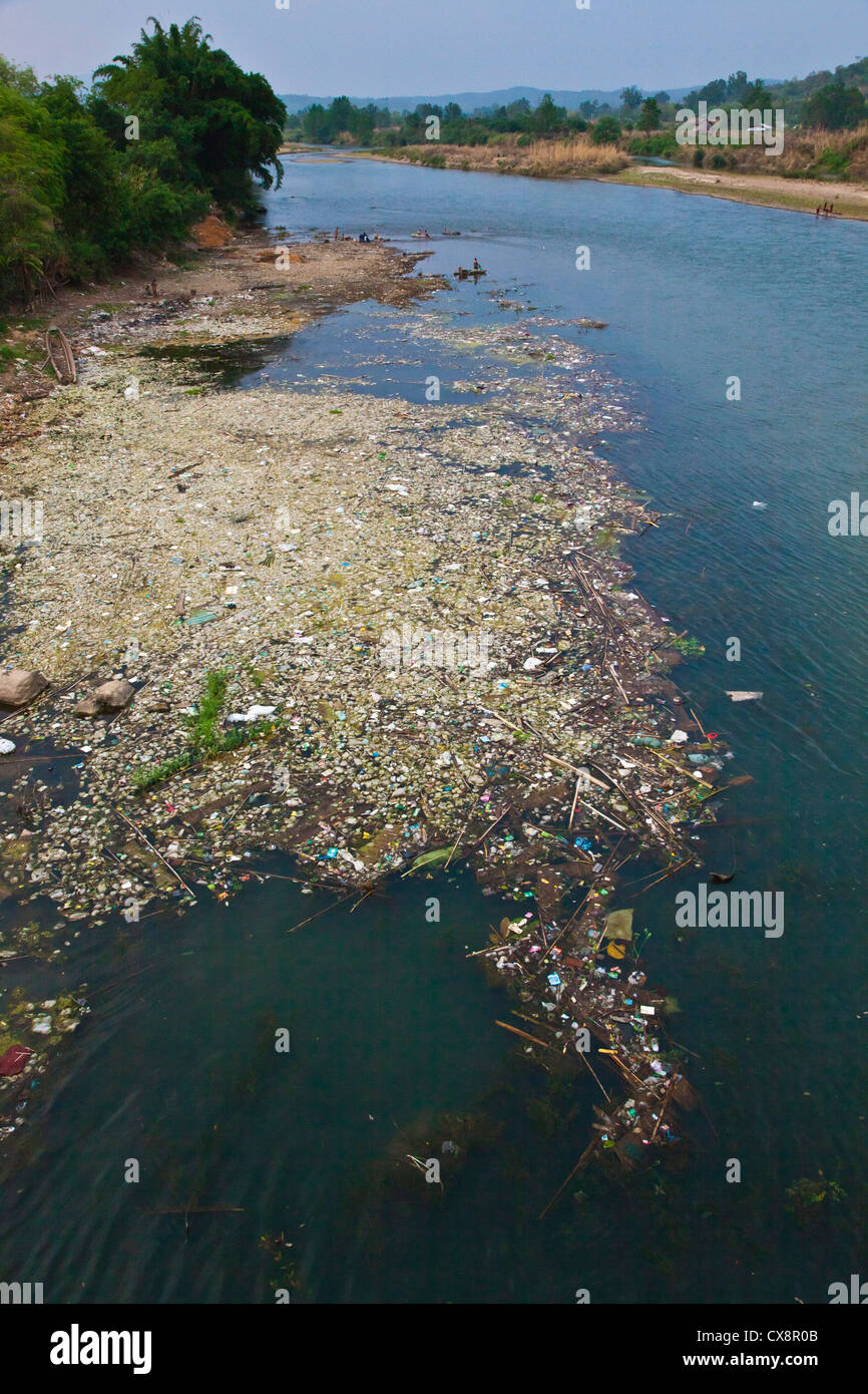 Floating TRASH on the DOKHTAWADY RIVER - HSIPAW, MYANMAR - Stock Image