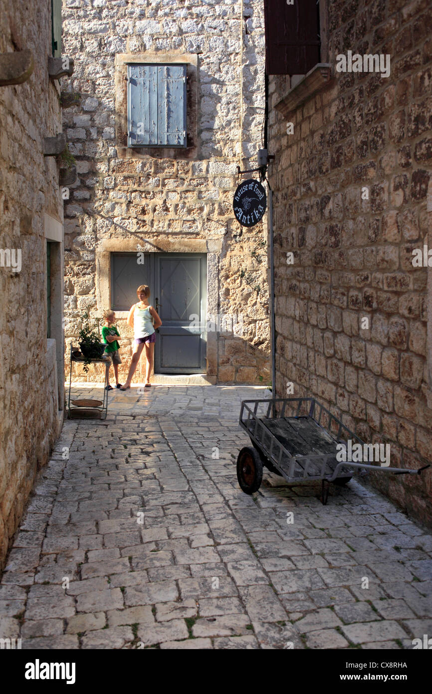 Narrow street in old town, Stari Grad, Island of Hvar, Dalmatian coast, Croatia - Stock Image