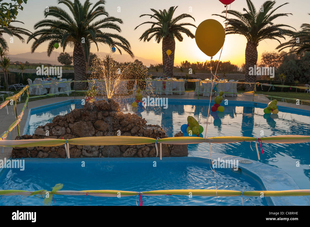 Pool side party before the guests arrive - Stock Image