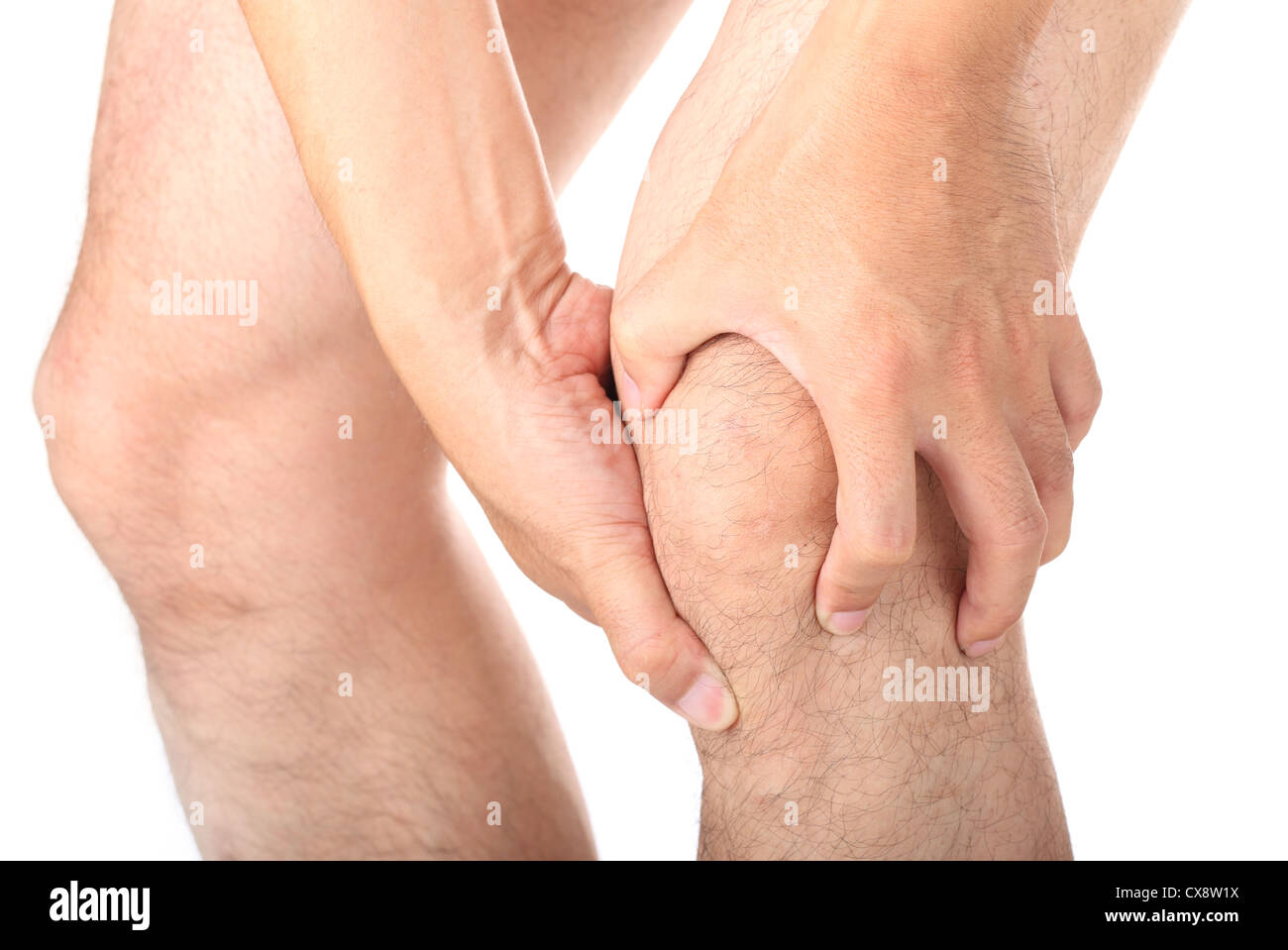 Man with knee pain on white background Stock Photo