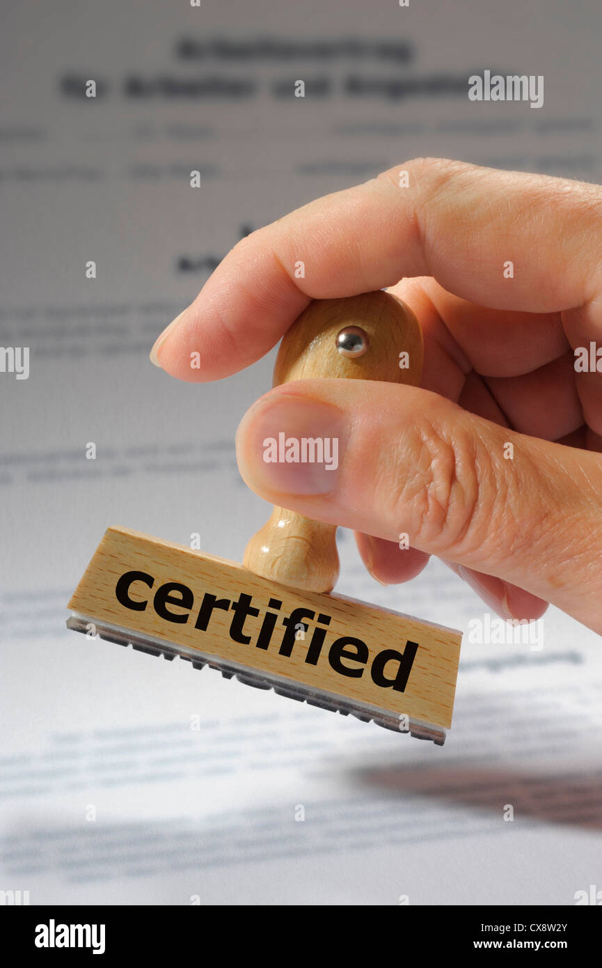 rubber stamp in hand marked with certified - Stock Image