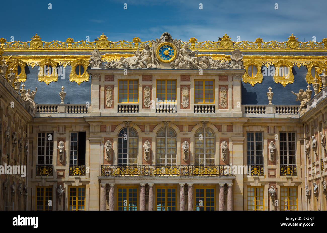The Palace of Versailles, or simply Versailles, is a royal château in Versailles in the Île-de-France - Stock Image