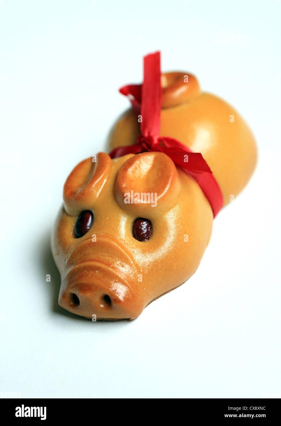 Mooncake in shape of little piggy. - Stock Image