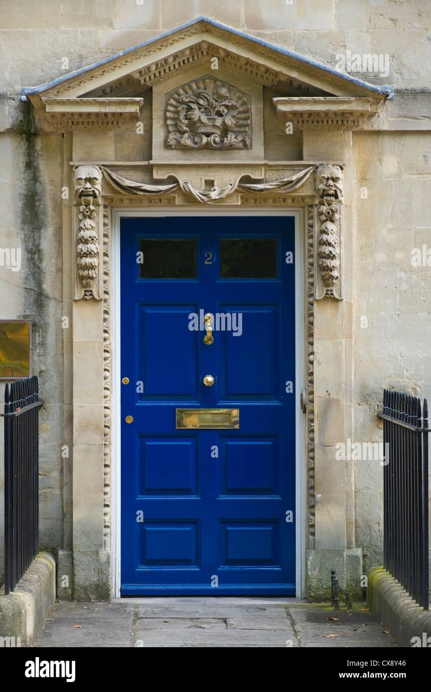 Number 2 blue wooden front door with triangular pediment of ...