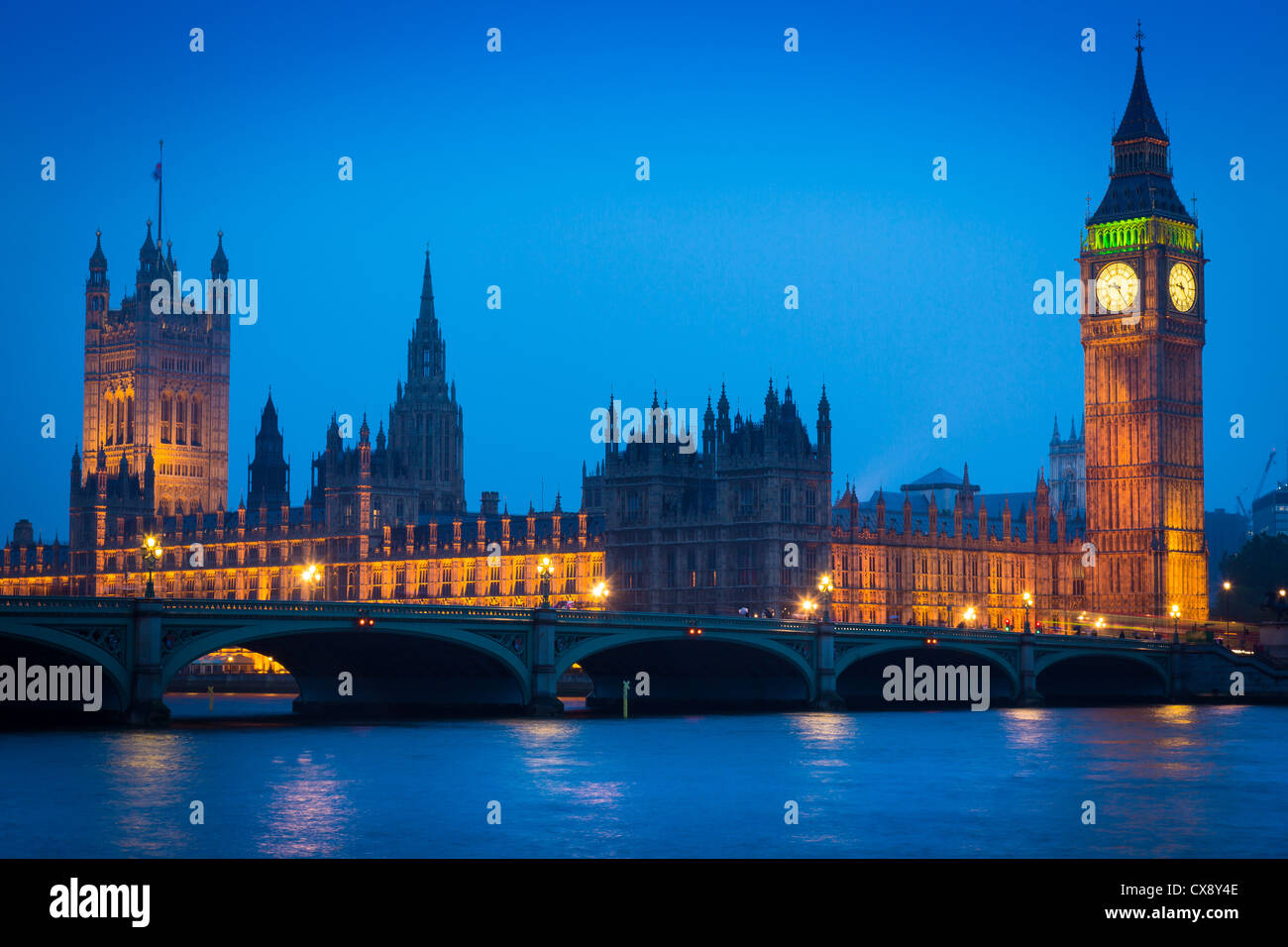 Westminster Bridge at night with Big Ben and the Houses of Parliament on the other side of the Thames - Stock Image