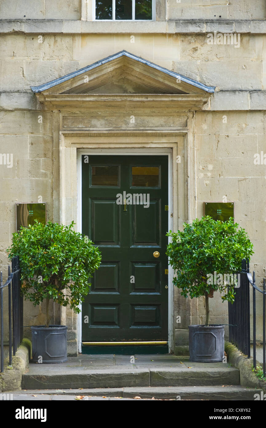 Number 1 Green Wooden Front Door With Triangular Pediment Of Georgian  Building In Bath Somerset England