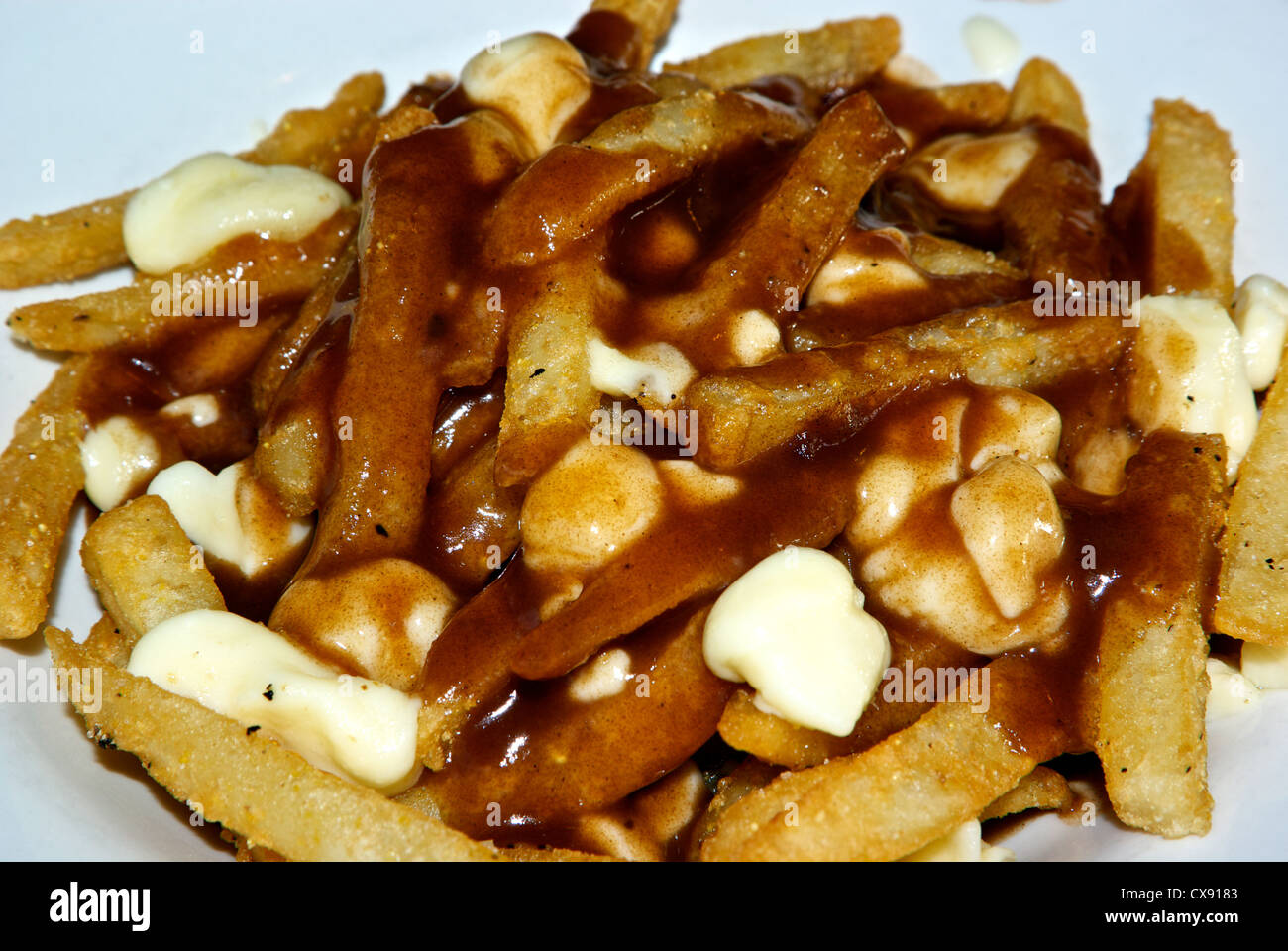 Poutine – Fries Topped With Gravy and Cheese Curds ...   Canadian Cheese Fries And Gravy