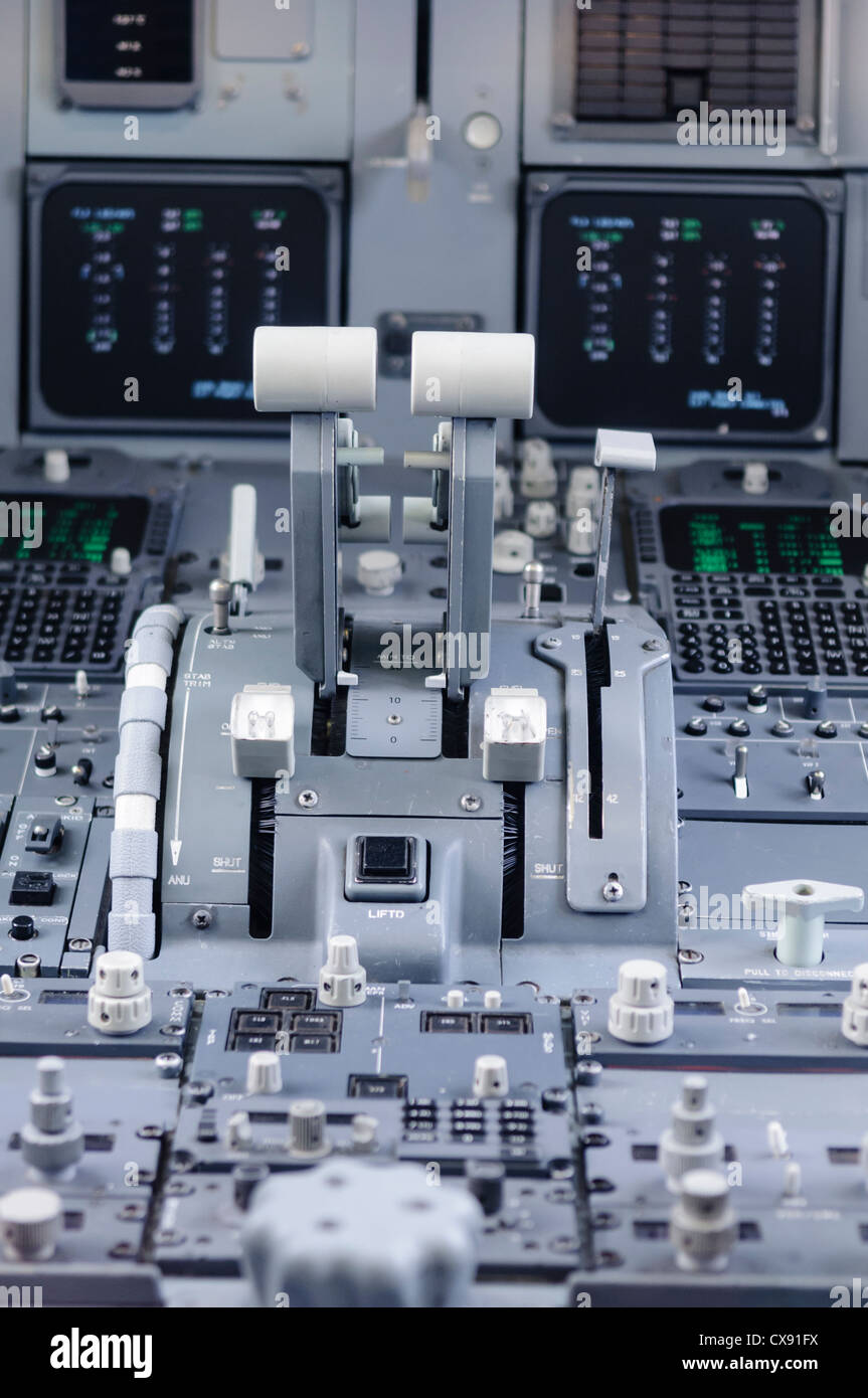 Central control panel and throttles of a KLM Fokker 100 - Stock Image