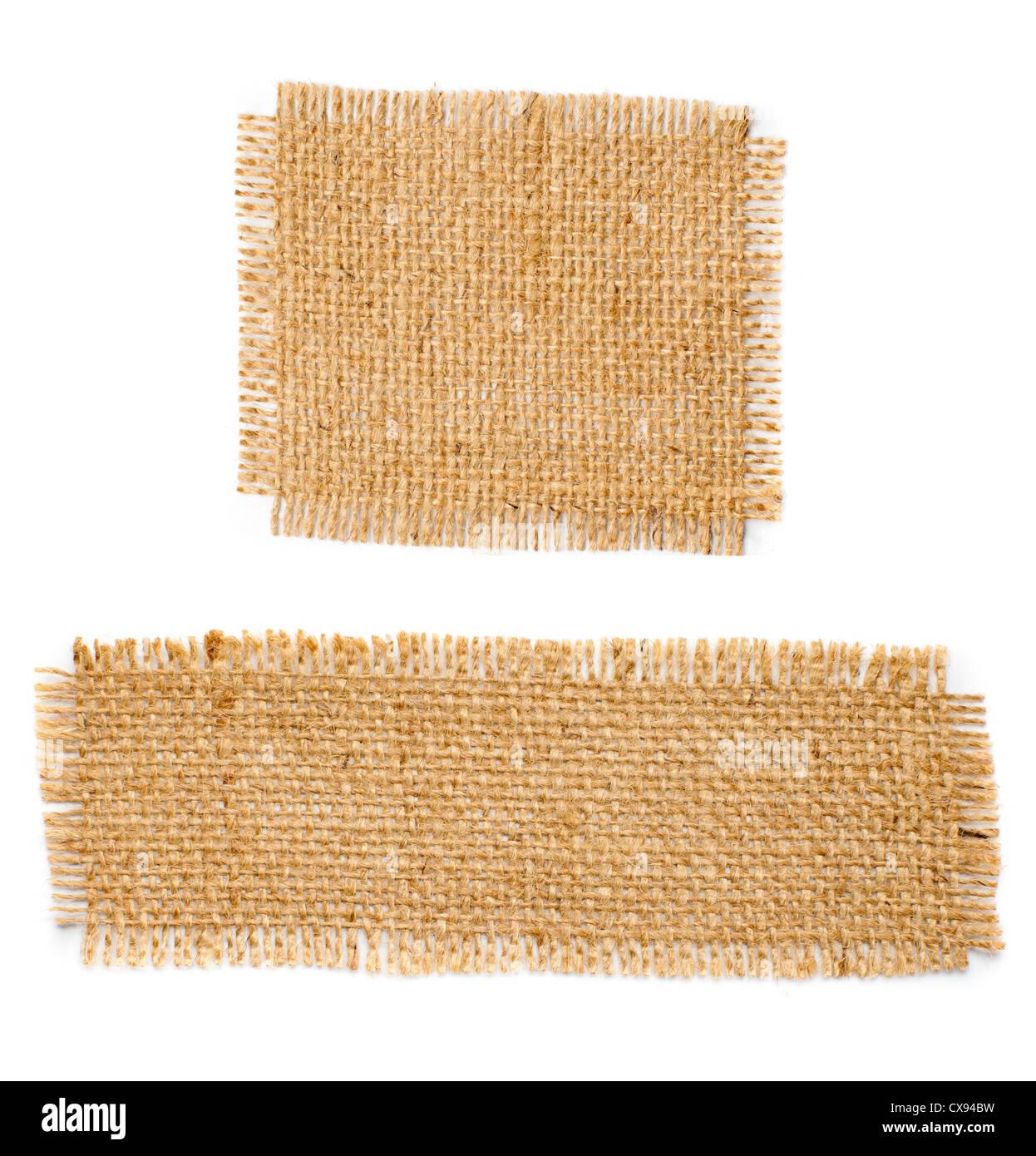 Burlap hessian square with frayed edges isolated on white background - Stock Image