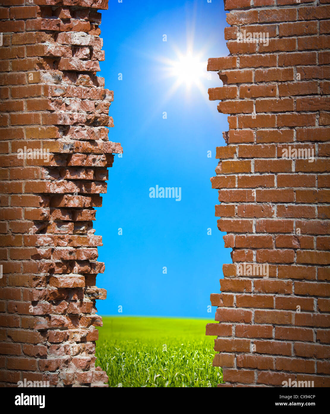 Broken wall freedom concept - Stock Image