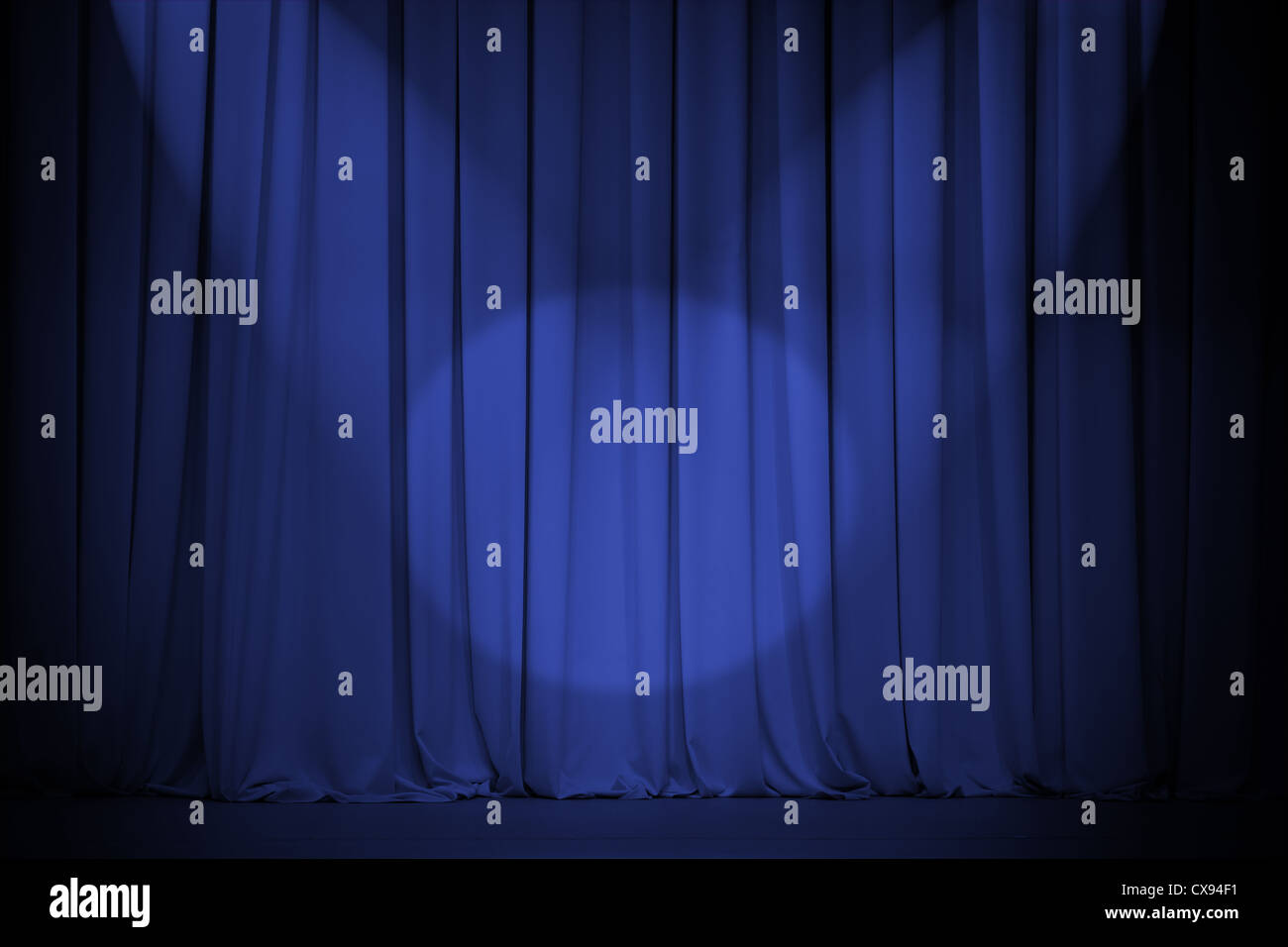 theater blue curtain with two lights cross - Stock Image
