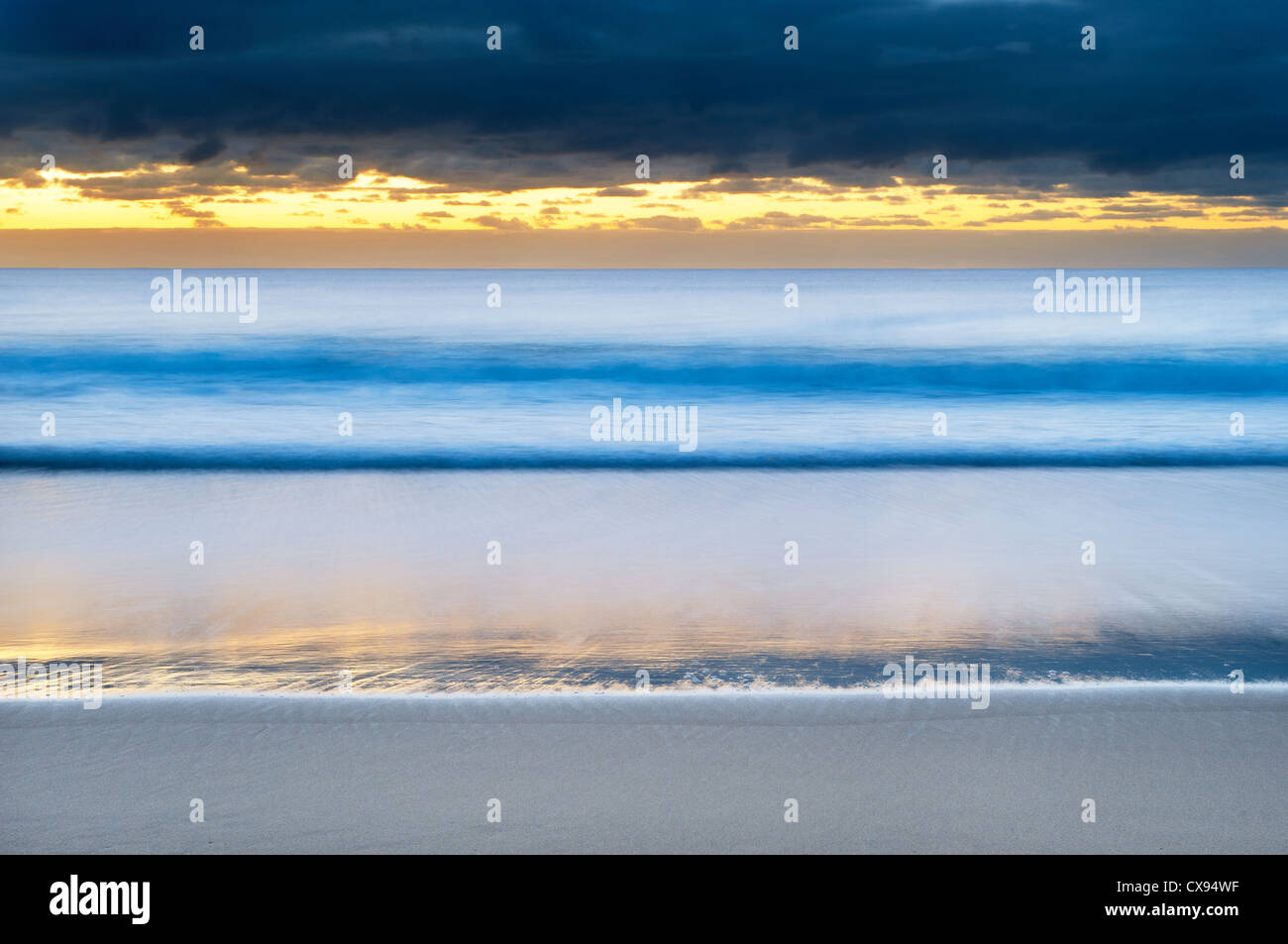 Cloudy dawn at Seven Mile Beach. - Stock Image