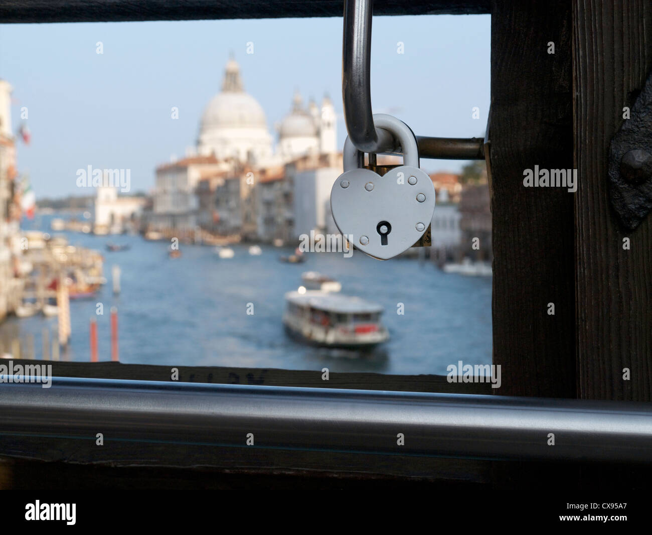 heart shaped love locks lovers padlock attached to the Ponte dell'Accademia bridge over the Grand Canal Venice Italy Stock Photo