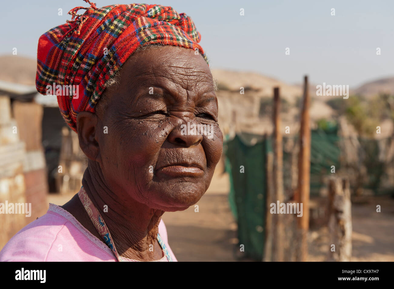 Older African woman in traditional dress - Stock Image