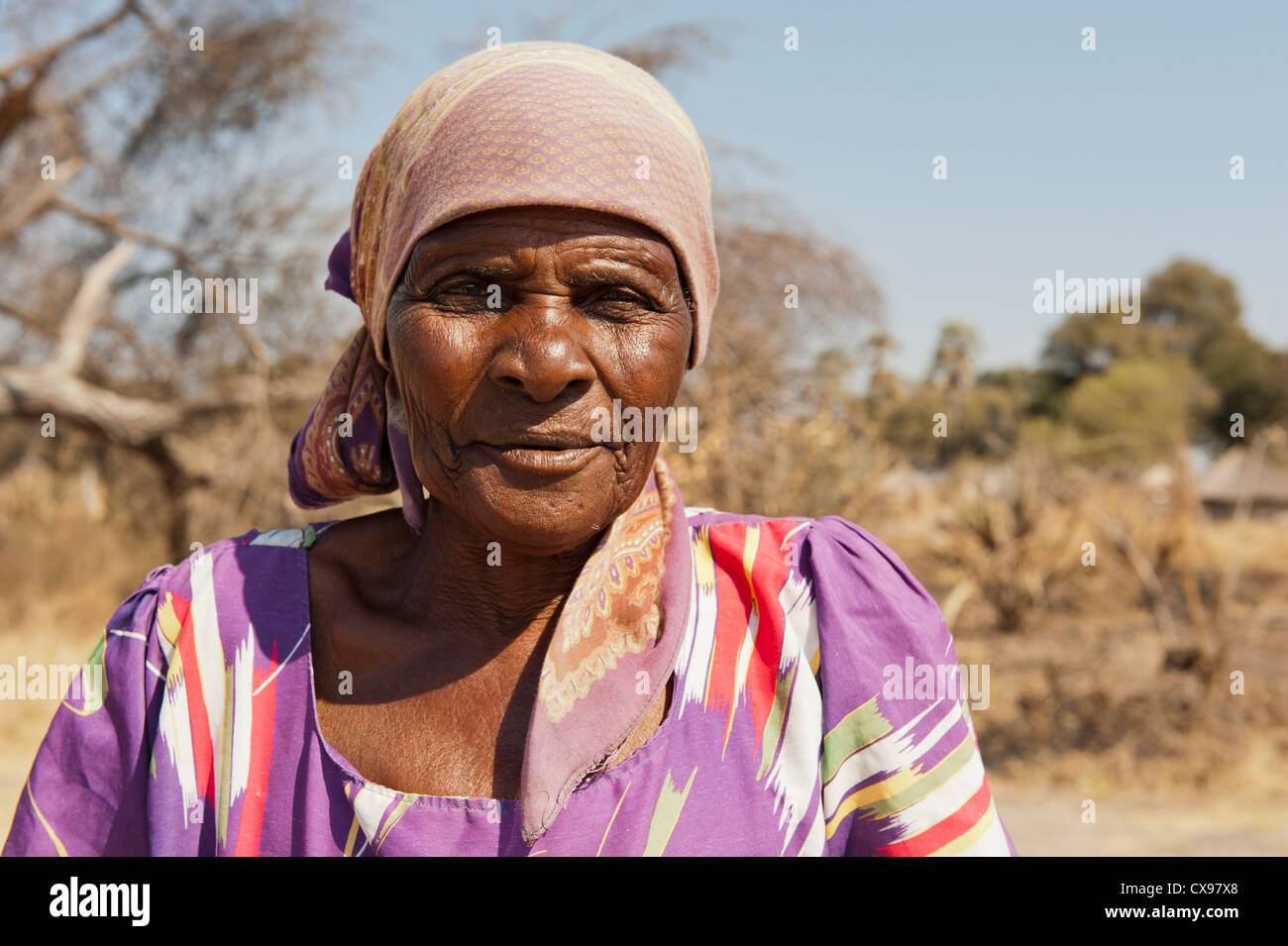 Older African woman in traditional dress in rural Botswana - Stock Image