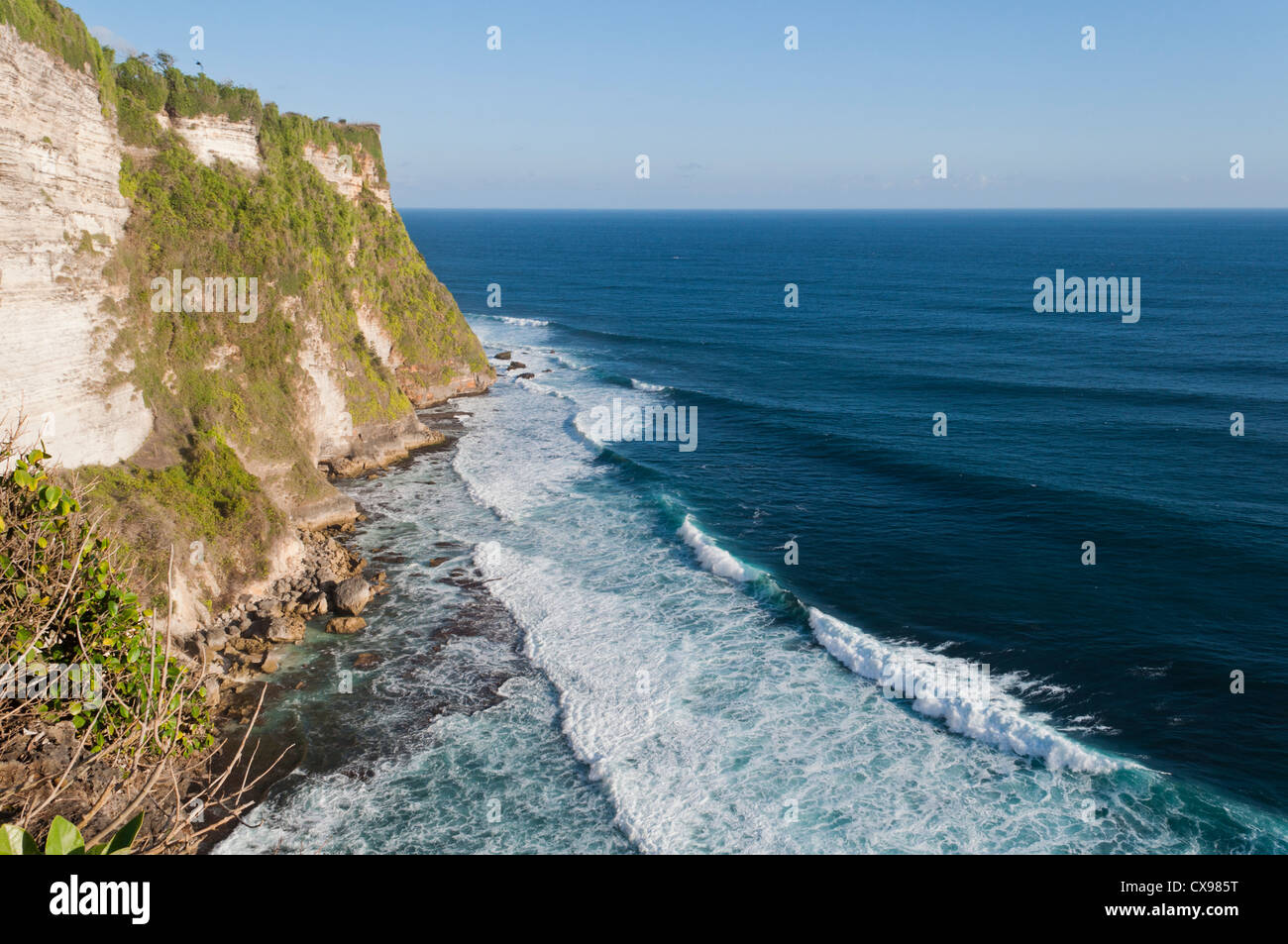 Surf and cliff near Ulawatu Temple - Stock Image