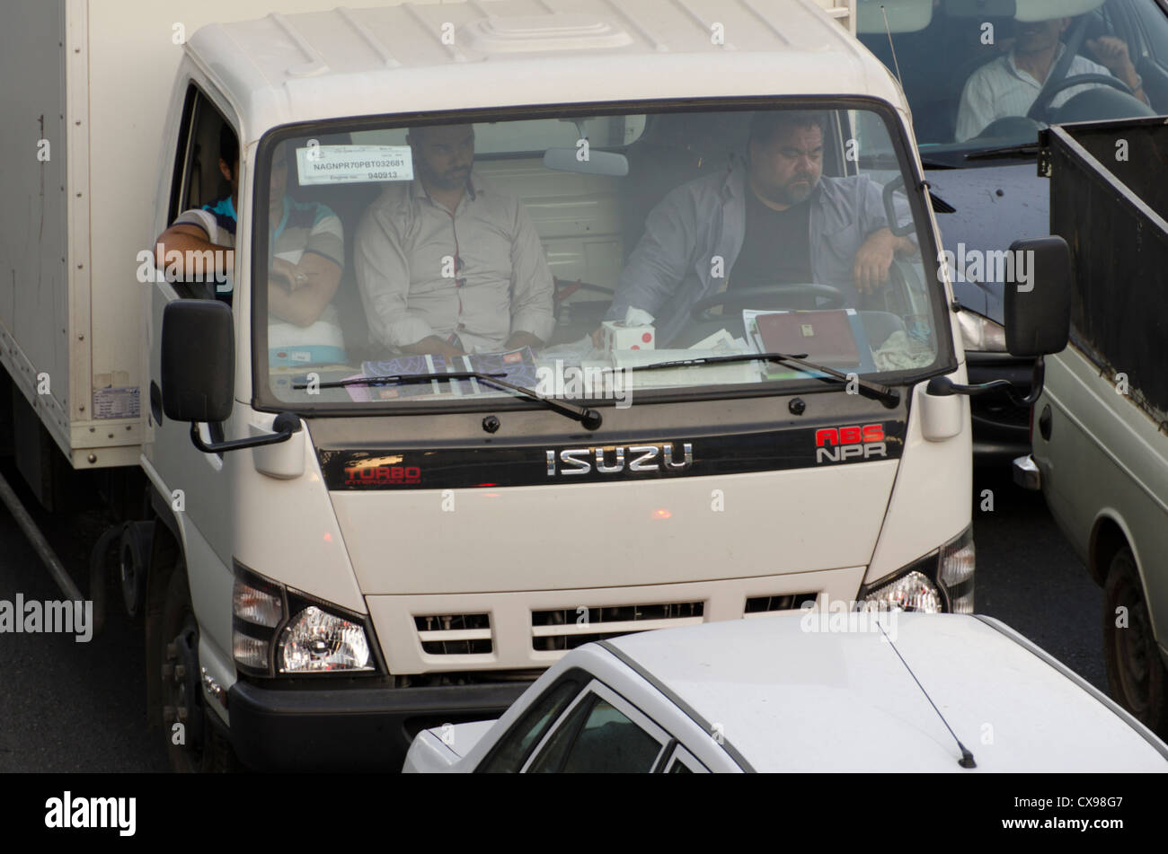 A truck driver and two passengers stuck in traffic jam in Tajrish, Tehran, Iran - Stock Image