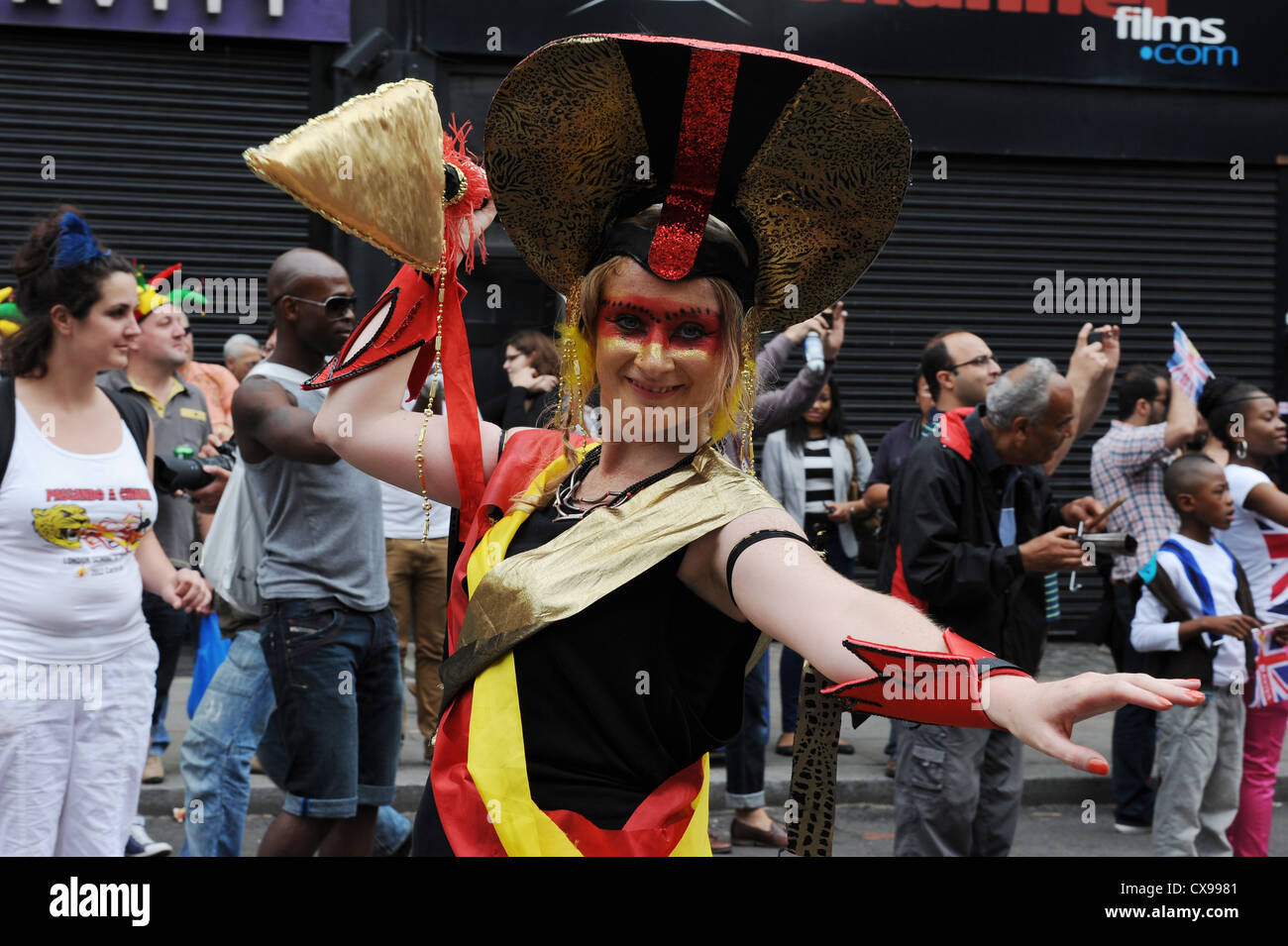 Woman in the parade at Notting Hill Carnival on Monday 27th August 2012. - Stock Image