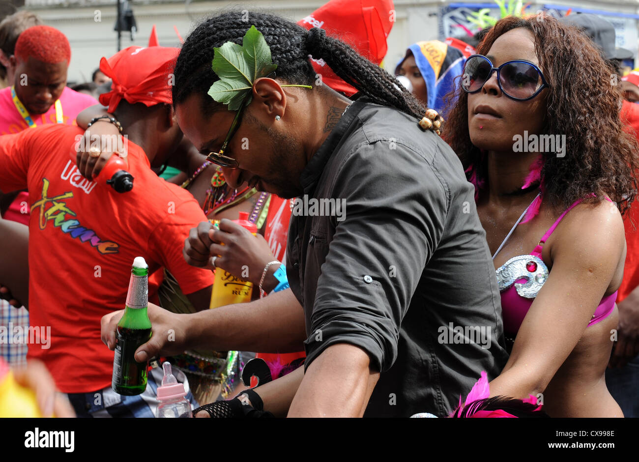 People at Notting Hill Carnival on Monday 27th August 2012 - Stock Image