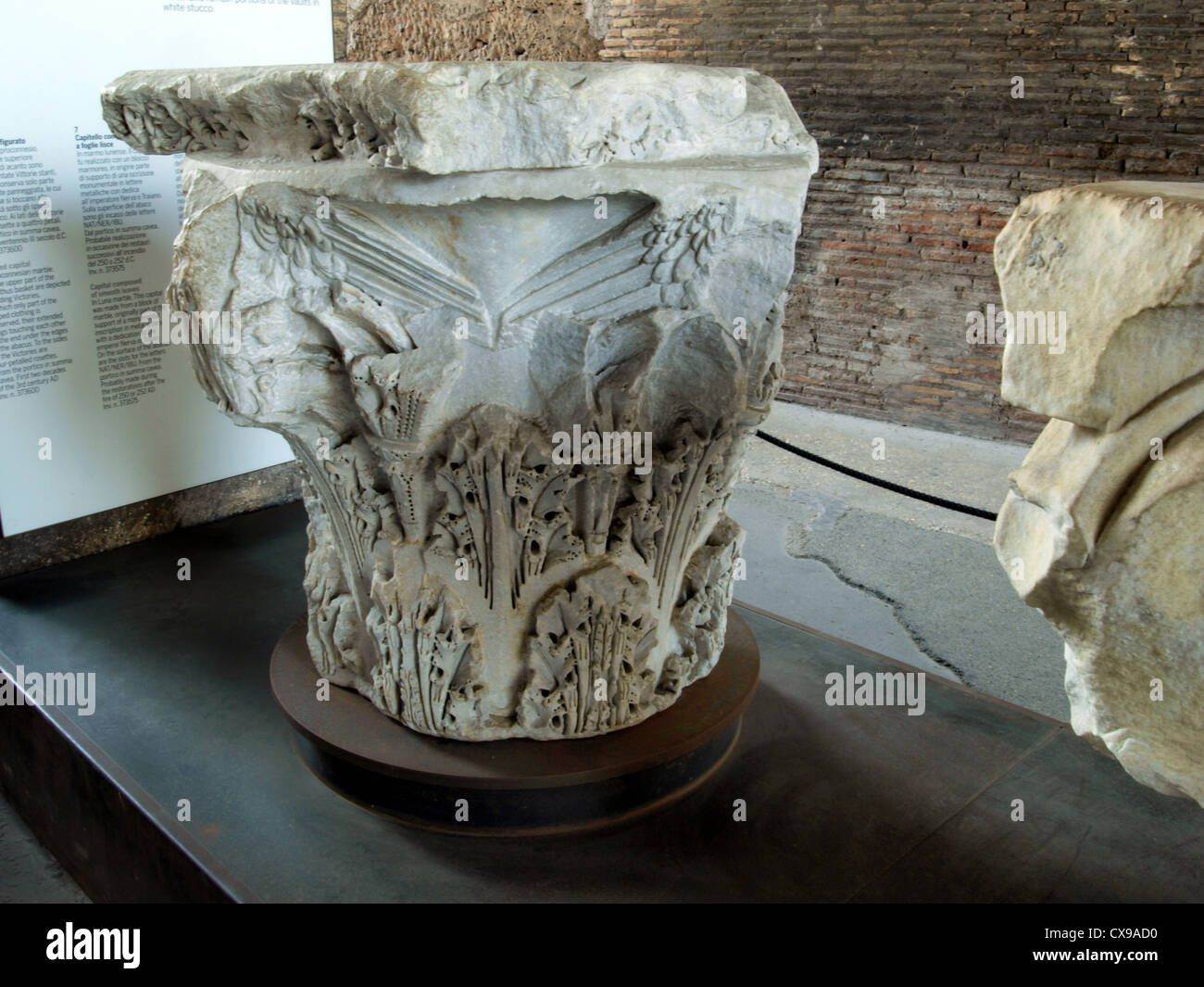 Interior of the Colosseum, Figured capital in Proconnesian marble. Stock Photo