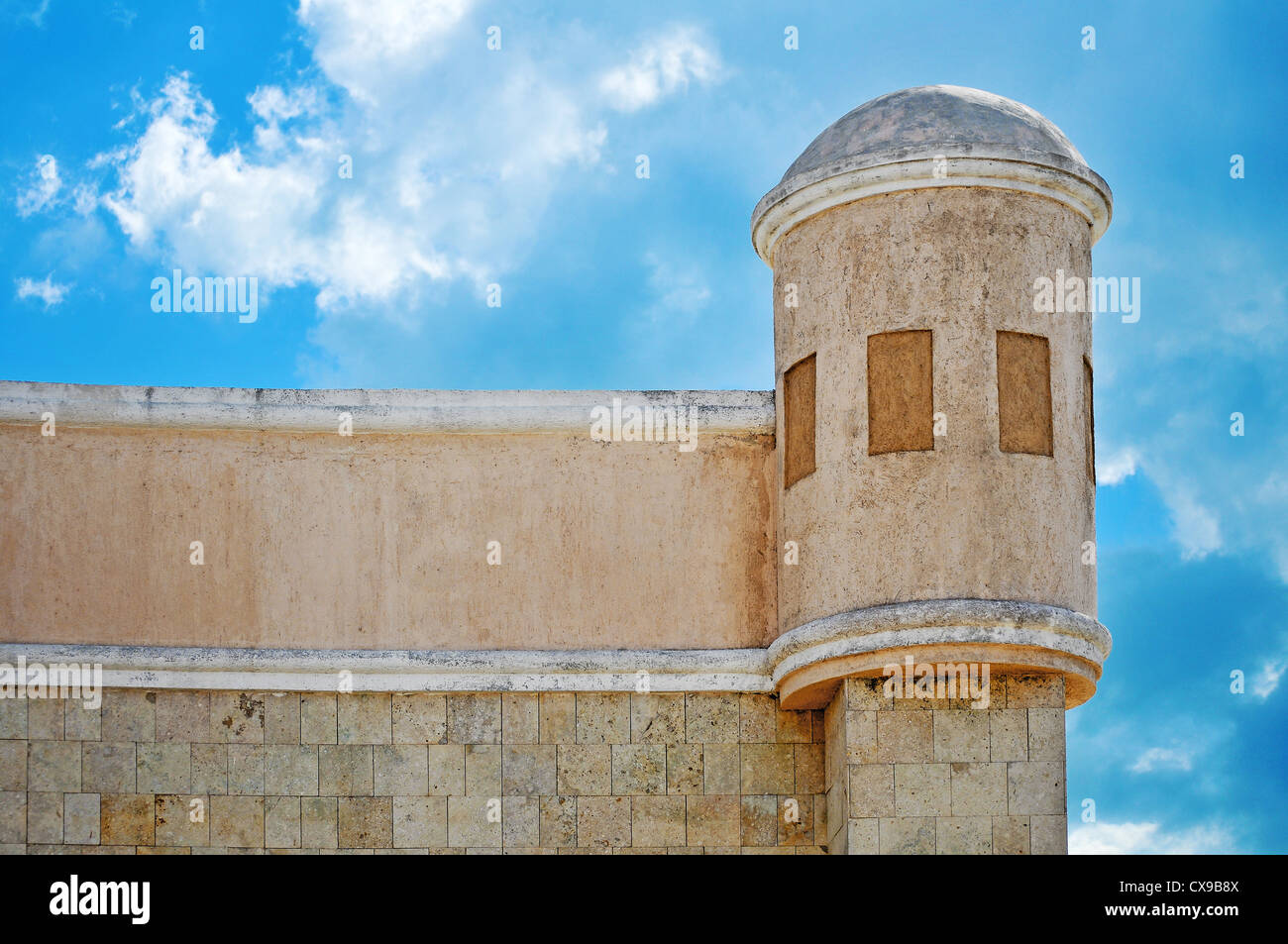 Old white wall and tower in Progresso - Mexico - Stock Image