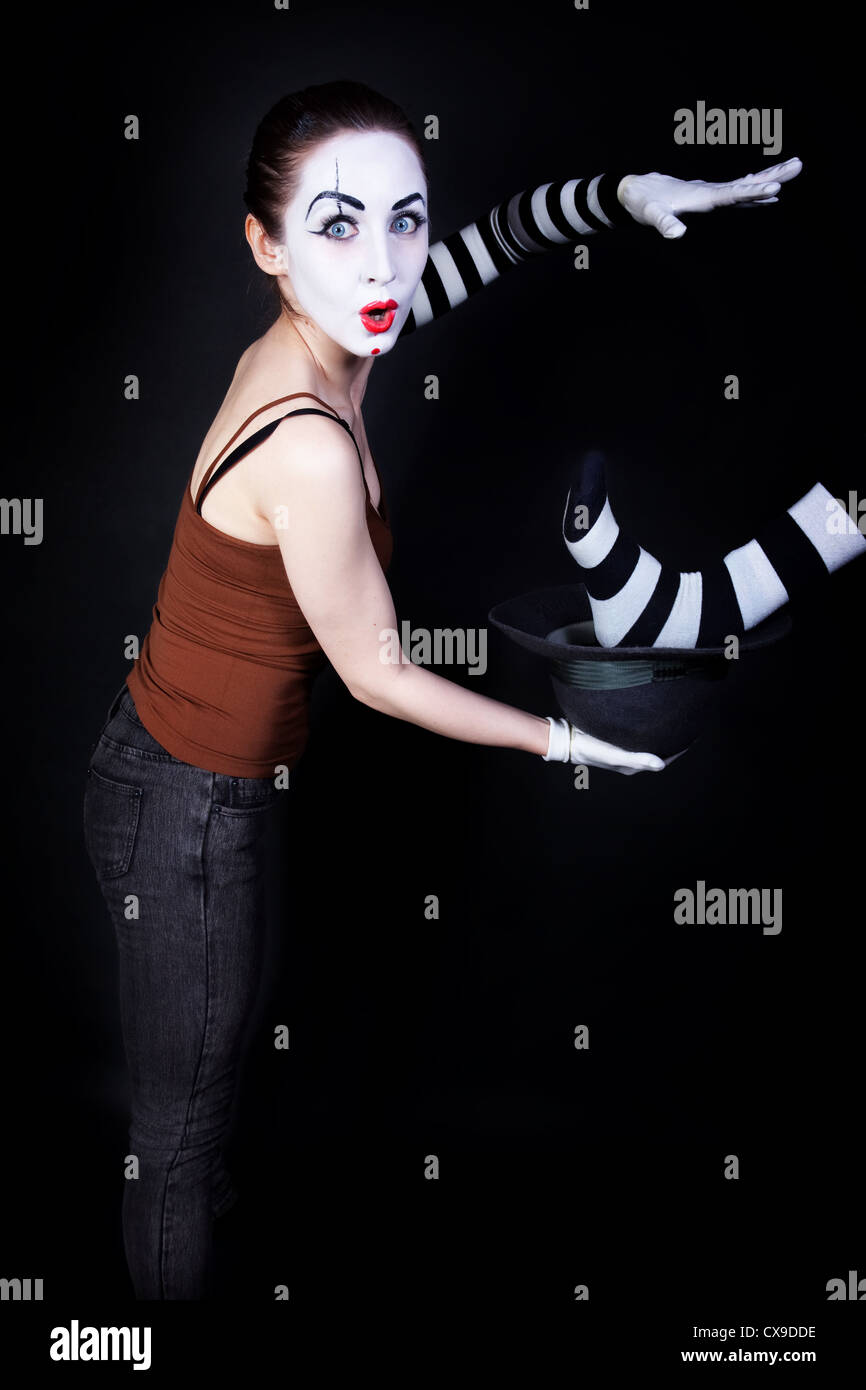 Woman mime performing focus on a black background - Stock Image