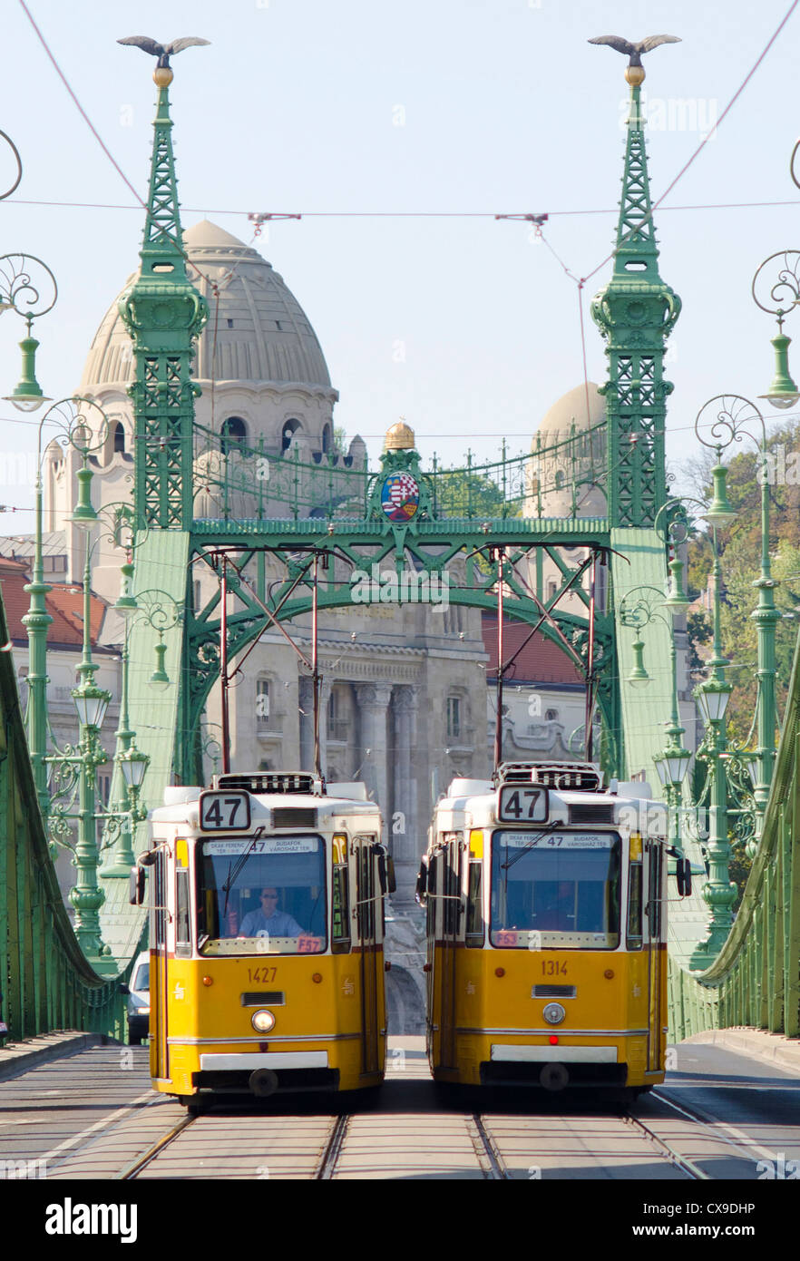 Two trams passing on the Green or Liberty bridge in Budapest, Hungary (Szabadság híd). Stock Photo